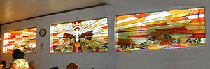 Stained glass tryptic designed for the Eucharistic Chapel at St. John the Evangelist Catholic Church in Tucson, Arizona.