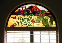One panel of a set of arched transoms created to block the intensity of the Southern Arizona sun and designed to mirror the view outside the windows of this home nestled in the Tucson Mountains.