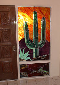 A majestic saguaro is the focal point for this two-part sidelight panel created to update the décor of an entryway to a home nestled in the Tucson Mountains.